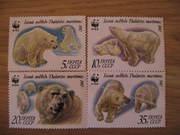 коллекционные марки белые медведи.четыре штуки не гошенные